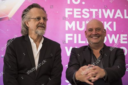 Stock Photo of Trevor Morris (L), a Canadian orchestral composer and Jan A. P. Kaczmarek (R), an Oscar-Winning Polish composer attend a press conference on the first day of the 10th edition of Krakow Film Music Festival in Krakow, Poland
