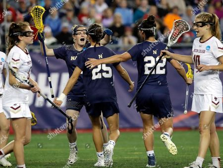 Stock Photo of Meg O'Donnell, Kayla Harris, Christina Walsh, Carly Bell Navy's Meg O'Donnell celebrates the goal of her teammate Kayla Harris (25) as Boston College's Christina Walsh, far left, and Carly Bell (10) react during the first half of an NCAA College Division 1 lacrosse semifinal, in Foxborough, Mass