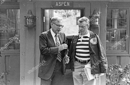 United States Secretary of Defense Harold Brown, left, and National Security Advisor Zbigniew Brezezinski, right, walk out of Aspen Lodge at Camp David, near Thurmont, Maryland following a meeting on the Egypt-Israel Summit.