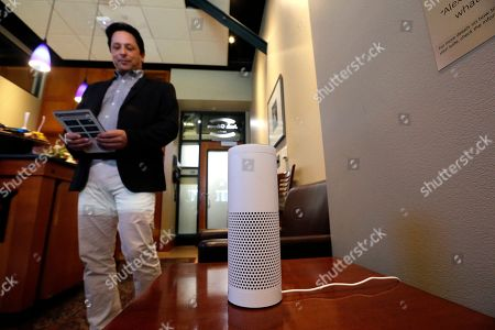 David Curry, Seattle Mariners technology vice president, demonstrates an Amazon Alexa device in a ballpark suite before a Mariners baseball game in Seattle. The Mariners have partnered with their hometown neighbors at Amazon to create the first integration between pro sports and Amazon's Alexa voice activated platform. It's currently an extra amenity for suite holders at Safeco Field, but the expansion opportunities to upgrade the fan experience seem boundless