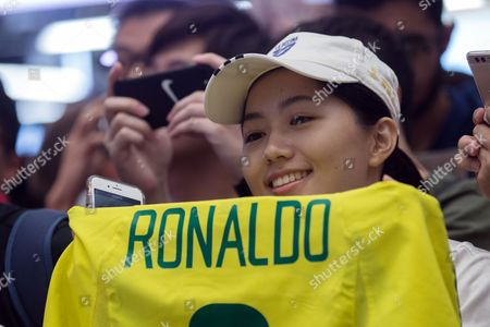 Stock Image of A fan of soccer legend Ronaldo Luis Nazario de Lima (unseen), who is better known by just his first name Ronaldo, holds a Ronaldo jersey during a promotional event with the soccer star for the 'Real Madrid Foundation Clinics' in Hong Kong, China, 27 May 2017. The former Brazilian international and Spanish Real Madrid club star recently launched the 'Ronaldo Academy' in Hong Kong and visited the site to celebrate the progress.