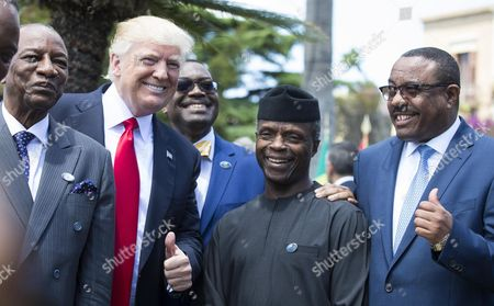 (L-R) Guinea's President Alpha Conde, US President Donald Trump, President of the African Development Bank Akinwumi Adesina, Nigeria's Vice President Yemi Osinbajo and Ethiopia's Prime Minister Hailemariam Desalegn pose for a group photo on the second day of the G7 Summit at the San Domenico in Taormina, Sicily, Italy, 27 May 2017. The second day is scheduled to deal with Innovationand Development in Africa, Global Issues such as Human Mobility, Food Security and Gender Equality as well as the G7 Global Relations, the Italian G7 Presidency said in a media release. Heads of States and of Governments of the G7, the group of most industrialized economies, plus the European Union, meet in Taormina, Italy, from 26 to 27 May 2017 for a summit titled 'Building the Foundations of Renewed Trust'.