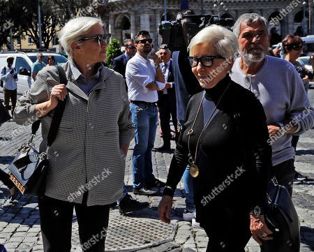 """Italian fashion designers Silvia Venturini Fendi, left, and Anna Fendi arrive for the funeral service of Laura Biagiotti in Rome,. Laura Biagiotti, an Italian fashion designer who conquered global markets with her soft, loose women's clothes and luxurious knits that won her the nickname """"Queen of Cashmere,"""" died Friday following a heart attack. She was 73"""