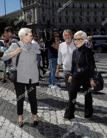 """Stock Picture of Italian fashion designers Silvia Venturini Fendi, left, and Anna Fendi arrive for the funeral service of Laura Biagiotti in Rome,. Laura Biagiotti, an Italian fashion designer who conquered global markets with her soft, loose women's clothes and luxurious knits that won her the nickname """"Queen of Cashmere,"""" died Friday following a heart attack. She was 73"""