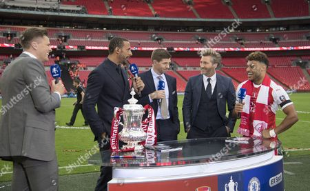 Alex Oxlade-Chamberlain of Arsenal is interviewed after the match by, l-r, BT Sport's Jake Humphreys, Rio Ferdinand, Steven Gerrard and Robbie Savage after the match