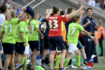 Wolfburg's head coach Ralf Kellermann (R) celebrates with team members after winning the German Women's DFB Cup final against SC Sand at Rheinenergiestadion in Cologne, Germany, 27 May 2017.