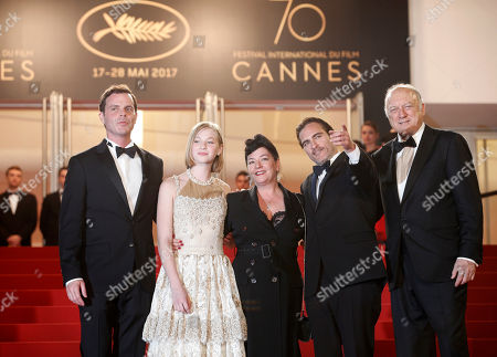 Stock Picture of John Doman, Joaquin Phoenix, Lynne Ramsay, Ekaterina Samsonov Actors Alex Manette, from left, Ekaterina Samsonov, director Lynne Ramsay, Joaquin Phoenix and John Doman pose for photographers upon arrival at the screening of the film You Were Never Really Here at the 70th international film festival, Cannes, southern France