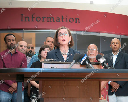 Oregon Gov. Kate Brown speaks at a news conference after a man fatally stabbed two men Friday on a light-rail train when they tried to stop him from yelling anti-Muslim slurs at two young women, one of whom was wearing a hijab in Portland, Ore., . Jeremy Joseph Christian, 35, was booked on suspicion of aggravated murder and attempted murder in the attack and will make a first court appearance Tuesday