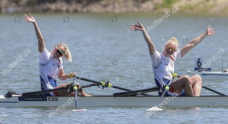 Kristyna Fleissnerova (L) and Lenka Antosova (R) from Czech Republic react after winning the Women's Double Sculls final during the Rowing European Championships in Racice, Czech Republic, 28 May 2017.