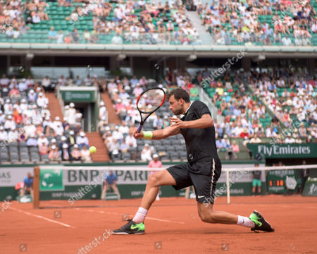 Stock Image of Grigor Dimitrov (BUL) (11) during his first round win over Stephane Robert (FRA).  Dimitrov  won the match in straight sets 6-2, 6-3, 6-4. French Open Tennis Championships, Roland Garros, Paris, France 28th May 2017.