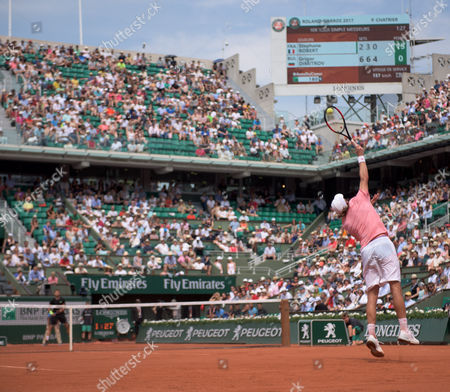 Stock Picture of Stephane Robert (FRA) serves to Grigor Dimitrov (BUL) (11).  Dimitrov  won the match in straight sets 6-2, 6-3, 6-4. French Open Tennis Championships, Roland Garros, Paris, France 28th May 2017.