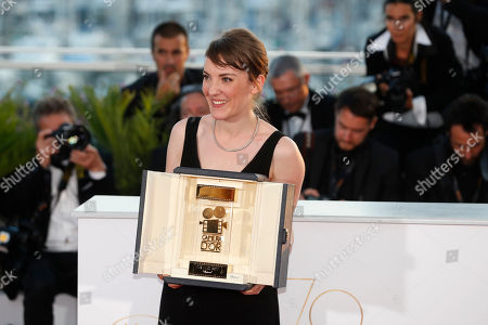 Director Leonor Serraille with her Camera d'Or award for best debut film Jeune Femme poses for photographers during a photo call following the awards ceremony at the 70th international film festival, Cannes, southern France