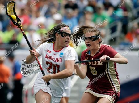 Taylor Hensh, Christina Walsh Maryland's Taylor Hensh (20) moves the ball against the defense of Boston College's Christina Walsh (8) during the first half of the NCAA college Division 1 lacrosse championship final, in Foxborough, Mass