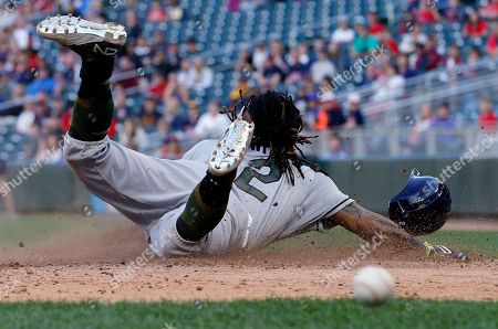 Tampa Bay Rays' Michael Martinez slides safely uncontested on a double by Corey Dickerson off Minnesota Twins relief pitcher Justin Haley in the 14th inning of a baseball game in Minneapolis. The Rays won 8-6 in 15 innings