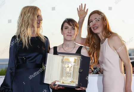 French director Leonor Serraille (C) and actress Laetitia Dosch (R) and Sandrine Kiberlain pose during the Award Winners photocall after they won the Golden Camera (Camera d'Or) award for the movie 'Jeunne Femme' at the 70th annual Cannes Film Festival in Cannes, France, 28 May 2017.