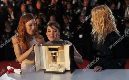 French director Leonor Serraille (C) and actress Laetitia Dosch (L) and Sandrine Kiberlain pose during the Award Winners photocall after they won the Golden Camera (Camera d'Or) award for the movie 'Jeunne Femme' at the 70th annual Cannes Film Festival in Cannes, France, 28 May 2017.