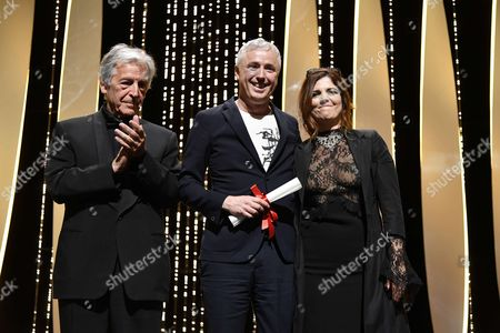 "Robin Campillo winner of the award of Grand Prix for ""120 Beats Per Minute (120 Battements Par Minute)"" with Costa-Gavras and Agnes Jaoui"