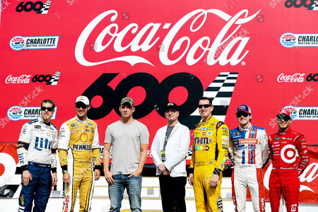 Grand Marshall Channing Tatum and Steven Soderbergh pose with Monster Energy NASCAR Cup Series driver Brad Keselowski (2), driver Joey Logano (22), driver Kyle Busch (18) driver Ryan Blaney (21), and driver Kyle Larson (42) to promote their new movie Logan Lucky at the Coca-Cola 600 at Charlotte Motor Speedway in Charlotte, NC
