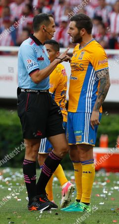 Tigres' Andre -pierre Gignac is admonished by referee Luis Enrique Santander Aguirre during the Mexican soccer league final match against Chivas,in Guadalajara, Mexico