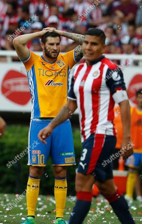 Tigres' Andre - pierre Gignac, left, looks on in disbelief after Chivas scored their second goal during the Mexican soccer league final match in Guadalajara, Mexico, . Chives won the match and the championship 2-1
