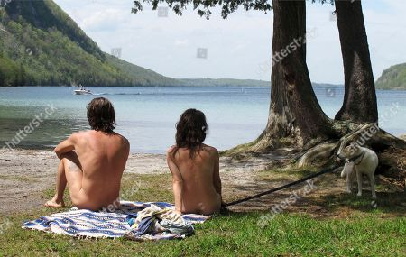 Michael Zarnowski, left, and Katelyn Comeau, of Thornton, N.H., relax at the clothing-optional beach known as the Southwest Cove of Lake Willoughby in Westmore, Vt. Located on state land, state officials said the area, which also includes hiking trails, gets so much use in the summer that upgrades need to be made to protect the area from over use. Beach users are opposed to the plan because they think it could threaten their ability to use the area