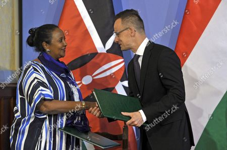 Hungarian Foreign Minister Peter Szijjarto (R) and Kenya's Foreign Minister Amina Mohamed (L) exchange copies of an intergovernmental agreement on a technological and economic cooperation programme in the Hungarian Ministry of Foreign Affairs and Trade in Budapest, Hungary, 29 May 2017.