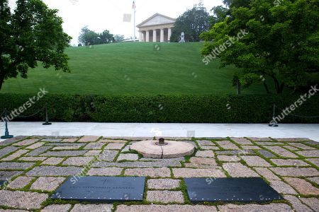 The graves of President John F. Kennedy, left, and his wife Jacqueline Kennedy Onassis at Arlington National Cemetery in Arlington, Va., . Kennedy was born May 29, 1917