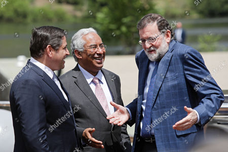 Prime Ministers of Portugal, Antonio Costa (C) and Mariano Rajoy (R), chat with Portuguese businessman Mario Ferreira (L) during a trip on Douro River on their way to the city of Vila Real, Portugal, 29 May 2017. The 29th Spanish-Portuguese Summit will take place at the city.