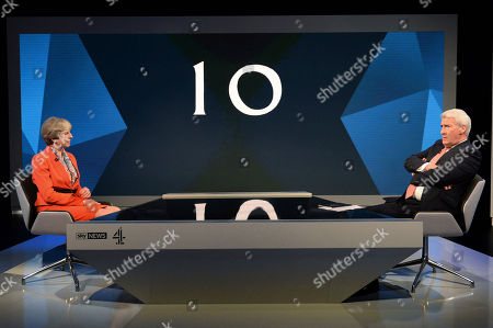 Britain's Prime Minister Theresa May, left is interviewed by broadcaster Jeremy Paxman, during a general election broadcast, in London, . ?Prime Minister Theresa May and Labour Party leader Jeremy Corbyn will face a live studio audience and a tough TV interviewer as the general election campaign moves to the airwaves