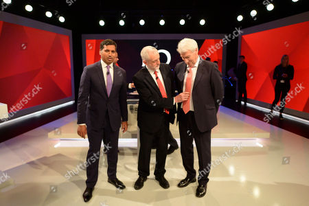 Labour leader Jeremy Corbyn, centre, adjusts the tie of Jeremy Paxman as they stand alongside Sky News political editor Faisal Islam during a general election broadcast, in London, . ?Prime Minister Theresa May and Labour Party leader Jeremy Corbyn will face a live studio audience and a tough TV interviewer as the general election campaign moves to the airwaves