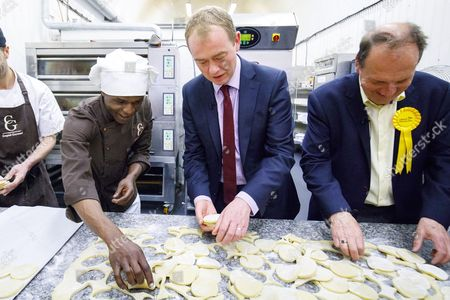 Leader of Liberal Democrats Tim Farron helps making pastry on a visit to Comptoir Gourmand Bakery shop in Bermondsey, London with former Bermondsey and Old Southwark MP Sir Simon Hughes