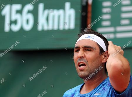 Marcos Baghdatis of Cyprus reacts as he plays against Nicolas Almagro of Spain during their men's 1st round single match  during the French Open tennis tournament at Roland Garros in Paris, France, 30 May 2017.