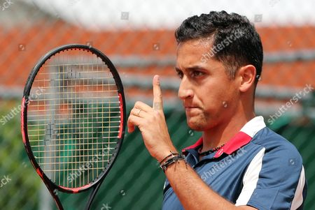 Nicolas Almagro of Spain reacts as he plays against Marcos Baghdatis of Cyprus during their men's 1st round single match during the French Open tennis tournament at Roland Garros in Paris, France, 30 May 2017.