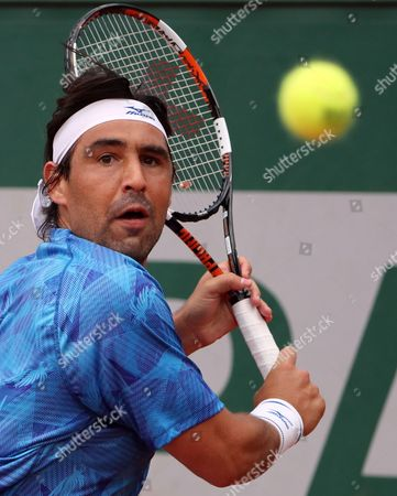 Marcos Baghdatis of Cyprus plays against Nicolas Almagro of Spain during their men's 1st round single match  during the French Open tennis tournament at Roland Garros in Paris, France, 30 May 2017.