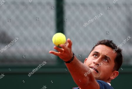 Nicolas Almagro of Spain  serves against Marcos Baghdatis of Cyprus during their men's 1st round single match during the French Open tennis tournament at Roland Garros in Paris, France, 30 May 2017.