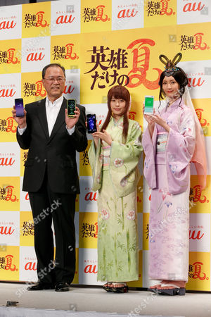 Takashi Tanaka, President of AU's parent KDDI Corporation, actresses Kasumi Arimura and Nanao wearing traditional Japanese kimono pose for cameras during a press conference for the new mobile devices of AU's 2017 Summer Selection