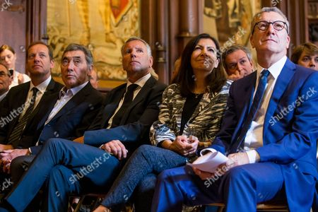 Stock Photo of (L-R) 'Tour de France' General Director Christian Prudhomme, Belgian cycling legend Eddy Merckx, the alderman of the sports of Brussels city Alain Courtois, Paris' mayoress Anne Hidalgo and Brussels' Mayor, Yvan Mayeur attend a press conference for the Tour de France 2019, in Brussels, Belgium, 30 May 2017. The Tour de France 2019 will start in Brussels to mark the 50th anniversary of Merckx' first win at the Tour de France.