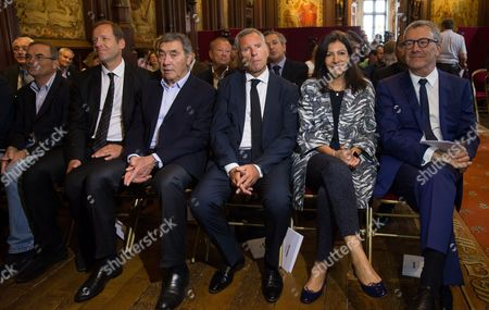 Stock Image of (L-R) 'Tour de France' General Director Christian Prudhomme, Belgian cycling legend Eddy Merckx, the alderman of the sports of Brussels city Alain Courtois, Paris' mayoress Anne Hidalgo and Brussels' Mayor, Yvan Mayeur attend a press conference for the Tour de France 2019, in Brussels, Belgium, 30 May 2017. The Tour de France 2019 will start in Brussels to mark the 50th anniversary of Merckx' first win at the Tour de France.