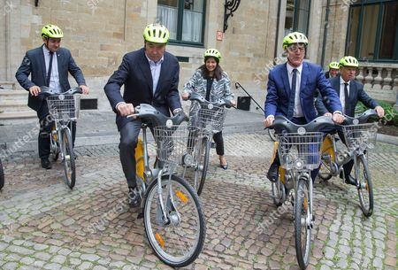 Stock Picture of (L-R) Belgian cycling legend Eddy Merckx, Paris' mayoress Anne Hidalgo, Brussels' Mayor Yvan Mayeur, the alderman of the sports of Brussels city Alain Courtois and 'Tour de France' General Director Christian Prudhomme take a short bike ride after a press conference for the Tour de France 2019, in Brussels, Belgium, 30 May 2017. The Tour de France 2019 will start in Brussels to mark the 50th anniversary of Merckx' first win at the Tour de France.