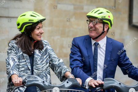 Paris' mayoress Anne Hidalgo (L) and Brussels' Mayor Yvan Mayeur (R) take a short bike ride after a press conference for the Tour de France 2019, in Brussels, Belgium, 30 May 2017. The Tour de France 2019 will start in Brussels to mark the 50th anniversary of Merckx' first win at the Tour de France.