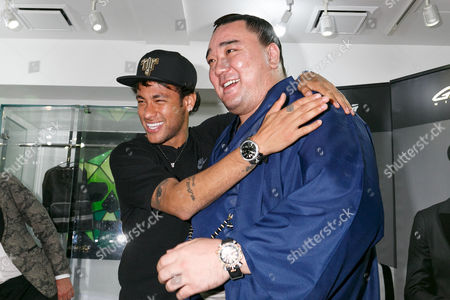 Stock Picture of Neymar Jr and Japanese sumo wrestler Harumafuji Kohei, pose for cameras at GaGa MILANO Harajuku store
