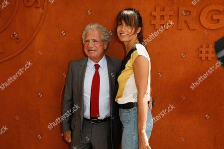 Laurent Dassault and Caroline Nielsen arrive at the Village of Roland Garros