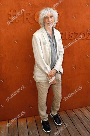 Louis Bertignac arrives at the Village of Roland Garros
