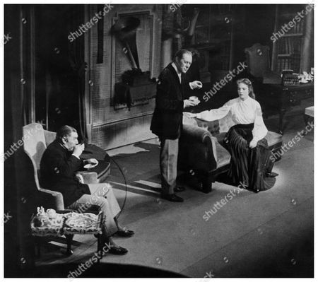 Editorial photo of Musical My Fair Lady On Broadway New York Picture Shows Robert Coote (1909-1982) As Colonel Pickering With Rex Harrison (1908-1990) As Professor Henry Higgins And Julie Andrews As Eliza Doolittle In The Stage Musical By Alan Jay Lerner And Frederick
