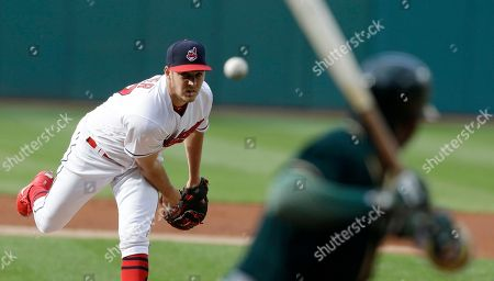Trevor Bauer, Rajai Davis Cleveland Indians starting pitcher Trevor Bauer delivers to Oakland Athletics' Rajai Davis in the first inning of a baseball game, in Cleveland