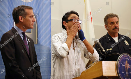 Stock Photo of Fernando Duran, Eric Garcetti, Charlie Beck Fernando Duran, father of murder victim Bree'Anna Guzman, thanks authorities as Los Angeles Mayor Eric Garcetti, left, and Police Chief Charlie Beck announce the arrest of a suspect in the 2011 kidnapping and murders of two young women, at police headquarters in downtown Los Angeles . Geovanni Borjas, 32, was charged with two counts each of murder and forcible rape, and one count of kidnapping in the deaths of 17-year-old Michelle Lozano and 22-year-old Bree'Anna Guzman, the Los Angeles County district attorney's office said