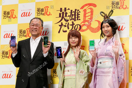 Takashi Tanaka, President of AU's parent KDDI Corporation, actresses Kasumi Arimura and Nanao wearing traditional Japanese kimono pose for cameras during a press conference for the new mobile devices of AU's 2017 Summer Selection, Tokyo, Japan.