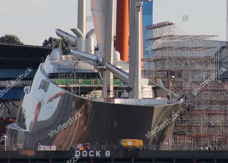 A photo made available 07 September 2016 shows a view to the giant sailing yacht 'Sailing Yacht A' in a dock in Kiel, Germany, 06 September 2016. The mostly completed 140-meters long new yacht ordered by Russian billionaire Andrey Melnichenko will do a first test trip in the upcomming weeks, according to information made available to German news agency dpa.