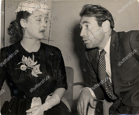 Bette Davis And Fourth Husband Actor Gary Merrill (married August 1950 - Divorced July 1960) At The Savoy Hotel In London For A Press Reception For The Film 'another Man's Poison'. Actress Bette Davis (april 5 1908 - October 6 1989). Gary Merrill (died 3/90) Often Referred To As 'the First Lady Of The American Screen ' Bette Davis Created A New Kind Of Screen Heroine. She Was A Liberated Woman In An Industry Dominated By Men. She Was Known As An Actress That Could Play A Variety Of Difficult And Powerful Roles And Because Of This She Set A New Standard For Women On The Big Screen. Independent Off-screen As Well Her Battles With Studio Bigwigs Were Legendary. With A Career Spanning Six Decades Few In The History Of Film Rival Her Longevity And Appeal. Bette Davis Was Born Ruth Davis On April 5 1908 In Lowell Massachusetts. Just Before Her Tenth Birthday Bette's Father Harlow Left The Family. Although She Had Little Money Her Mother Ruthie Sent Bette And Her Sister To Boarding School. Upon Graduating Cushing Academy Bette Enrolled In John Murray Anderson's Dramatic School. In 1929 She Made Her Broadway Debut In 'broken Dishes.' She Also Landed A Role In 'solid South.' In 1930 She Moved To Hollywood To Screen Test For Universal. Six Small Films Later Bette's Contract With Universal Was Not Renewed. She Wanted To Go Back To Broadway But A Phone Call From Warner Brothers Quickly Changed Her Mind. In 1932 She Signed A Seven-year Contract With Warner Brothers. The Film 'the Man Who Played God' (1932) Landed Bette On The Path To Stardom. She Was A Smash When She Was Lent Out To Rko For The Role Of Mildred In 'of Human Bondage' (1934) Her First Critically Acclaimed Hit. Her Role In 'dangerous' (1935) Led To Her Nomination For A Best Actress Oscar. She Became The First Warner Brothers Actress To Win The Coveted Award. Despite Her Success Warner Brothers Continued To Offer Bette Unsatisfactory Roles. In 1936 She Challenged The Studio By Going To Englan