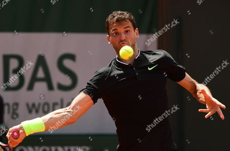 Grigor Dimitrov of Bulgaria in action against Tommy Robredo of Spain during their men?s single 2nd round match during the French Open tennis tournament at Roland Garros in Paris, France, 31 May 2017.